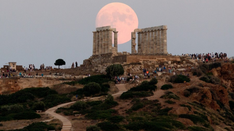 Photo taken on Aug. 2, 2020 shows almost full moon rising over the ancient Temple of Poseidon at Cape Sounion, 70 km southeast of Athens, Greece.