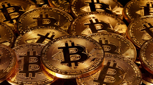 Cryptocurrency market value exceeds $1 trillion as Bitcoin reaches record-breaking level