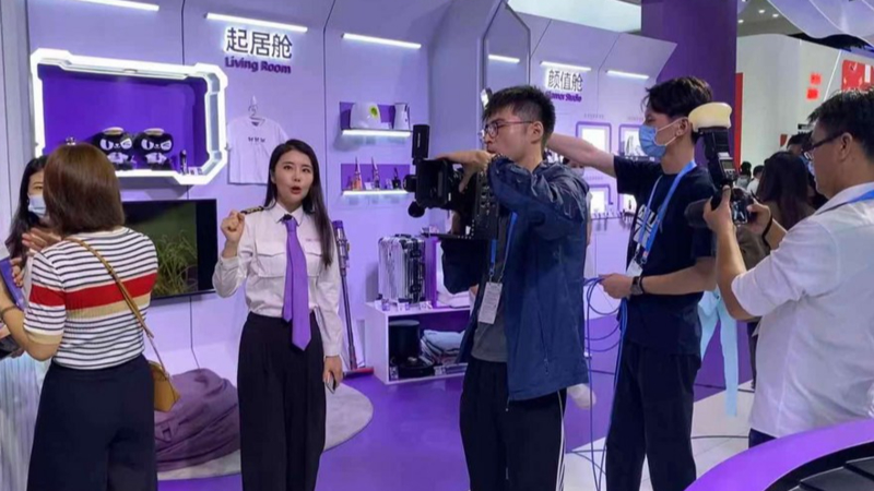 An e-commerce livestreaming anchor is introducing products to viewers at the first China International Consumer Products Expo in Haikou, capital of south China's Hainan Province, May 8, 2021.