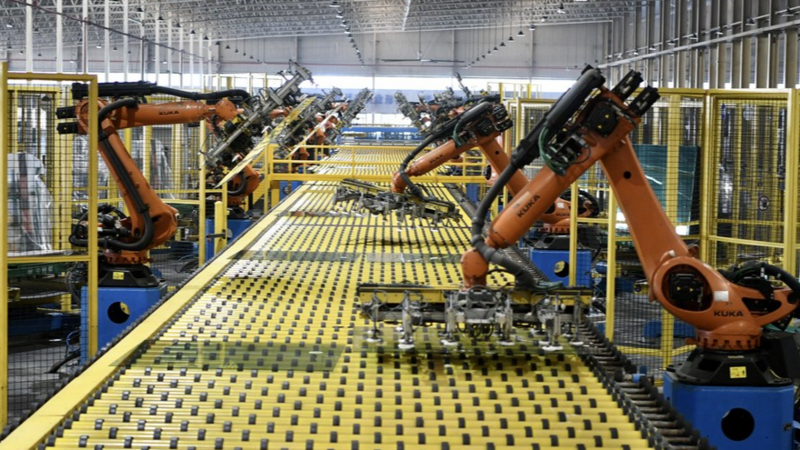 Robots operate on a production line at an automotive glass workshop of the Fuyao Glass Industry Group Co., Ltd. in Fuqing City of Fuzhou